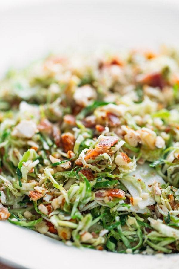 Bacon and Brussels Sprout Salad - paper-thin brussels sprouts with bacon, almonds, Parmesan, and a light citrus vinaigrette. Always everyone's favorite!