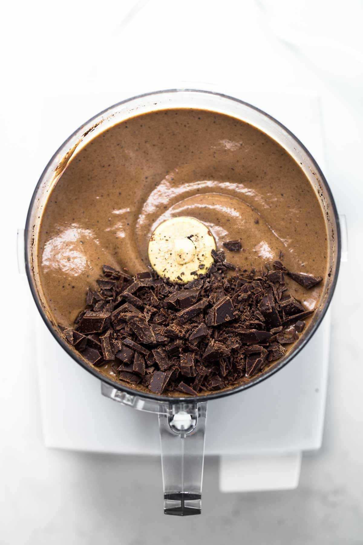 12 magical ways to use a food processor pinch of yum chocolate liquid and chocolate chunks in a food processor forumfinder Choice Image