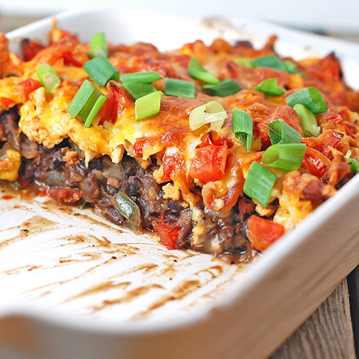 Black bean casserole is made with ground turkey, black beans, peppers, and cheese.