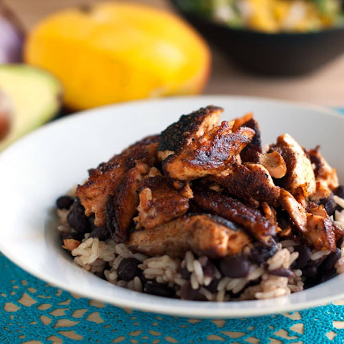 This Caribbean jerk salmon bowl with mango salsa is easy, full of flavor, and super healthy. This is feel-good food at its best! | pinchofyum.com