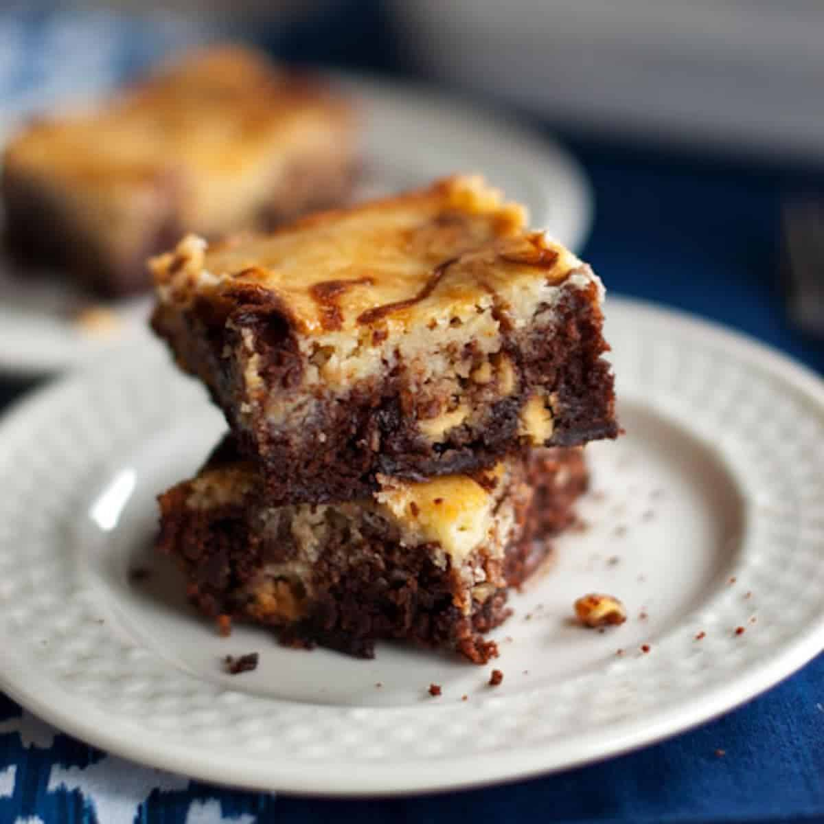These white chocolate cheesecake brownies are like two desserts in one! And it's the easiest recipe ever with just 6 ingredients. | pinchofyum.com