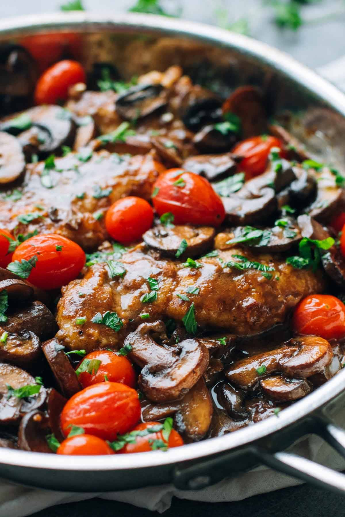 A simple Chicken Marsala recipe featuring fresh tomatoes, pan-fried chicken breasts, sauteed mushrooms, and a Marsala wine sauce. | pinchofyum.com