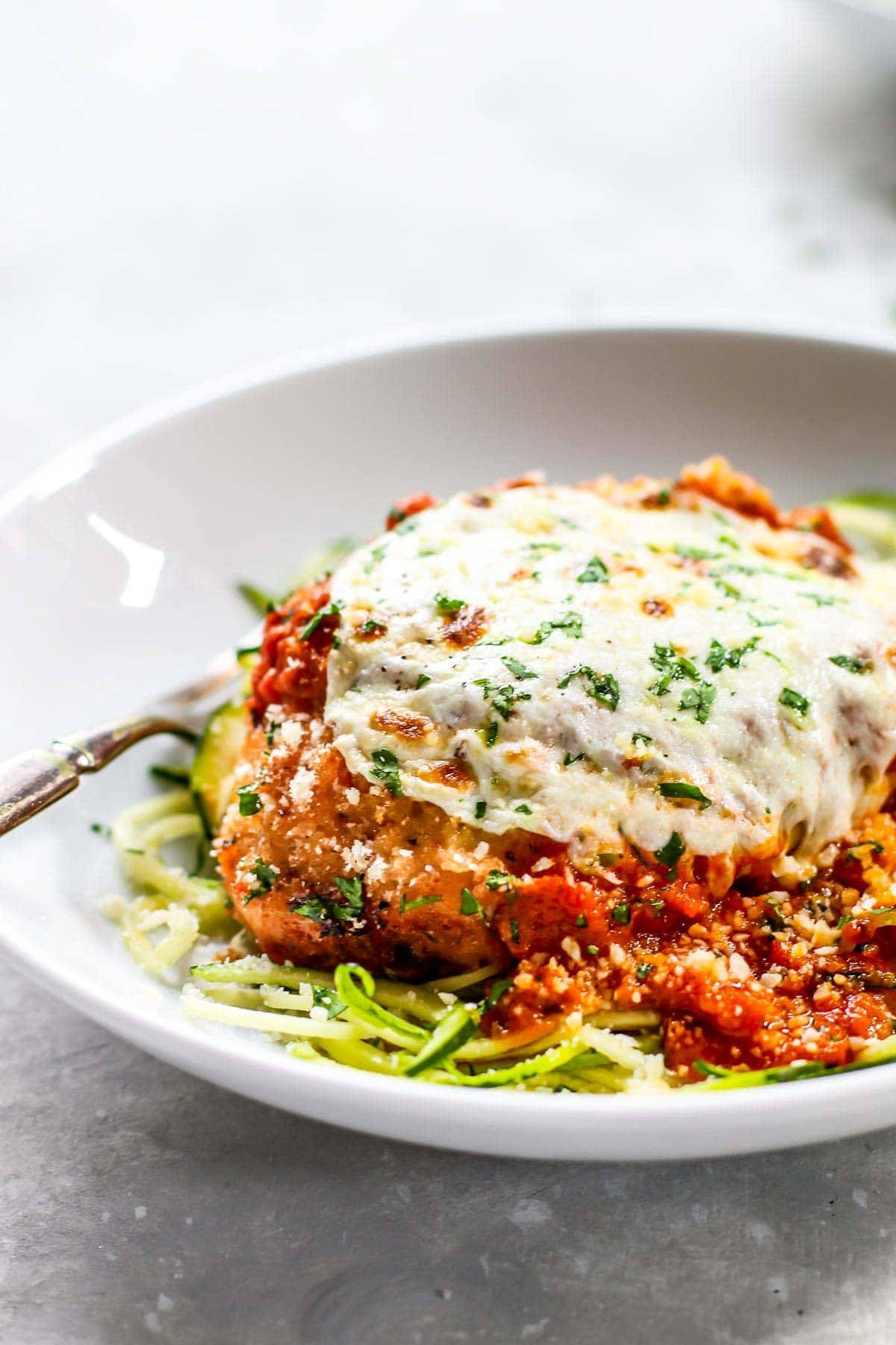 Chicken Parmesan on a white plate.