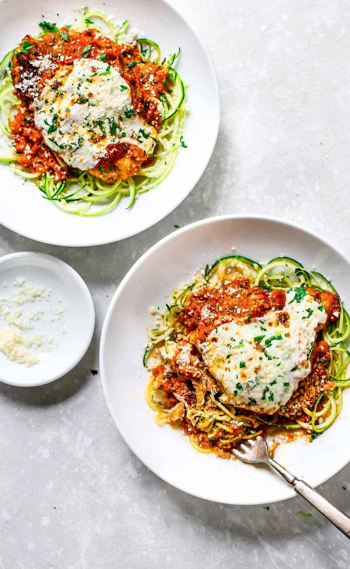 20 minute healthy chicken parmesan recipe pinch of yum chicken parmesan on two white plates forumfinder Choice Image