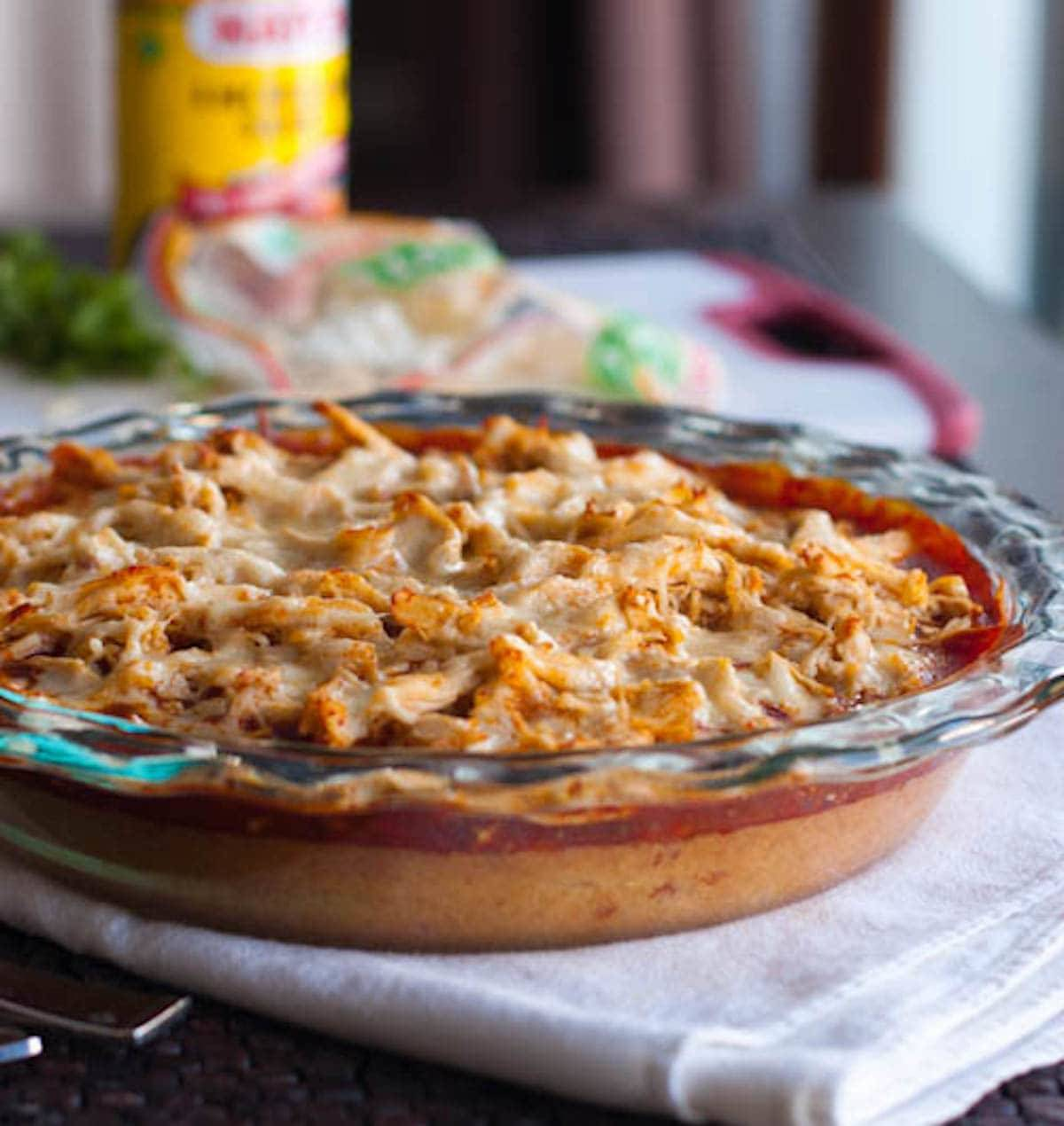 This chicken tamale pie is a huge crowd pleaser and so easy to make! A corn cake bottom layer topped with shredded chicken, enchilada sauce, and cheese. | pinchofyum.com