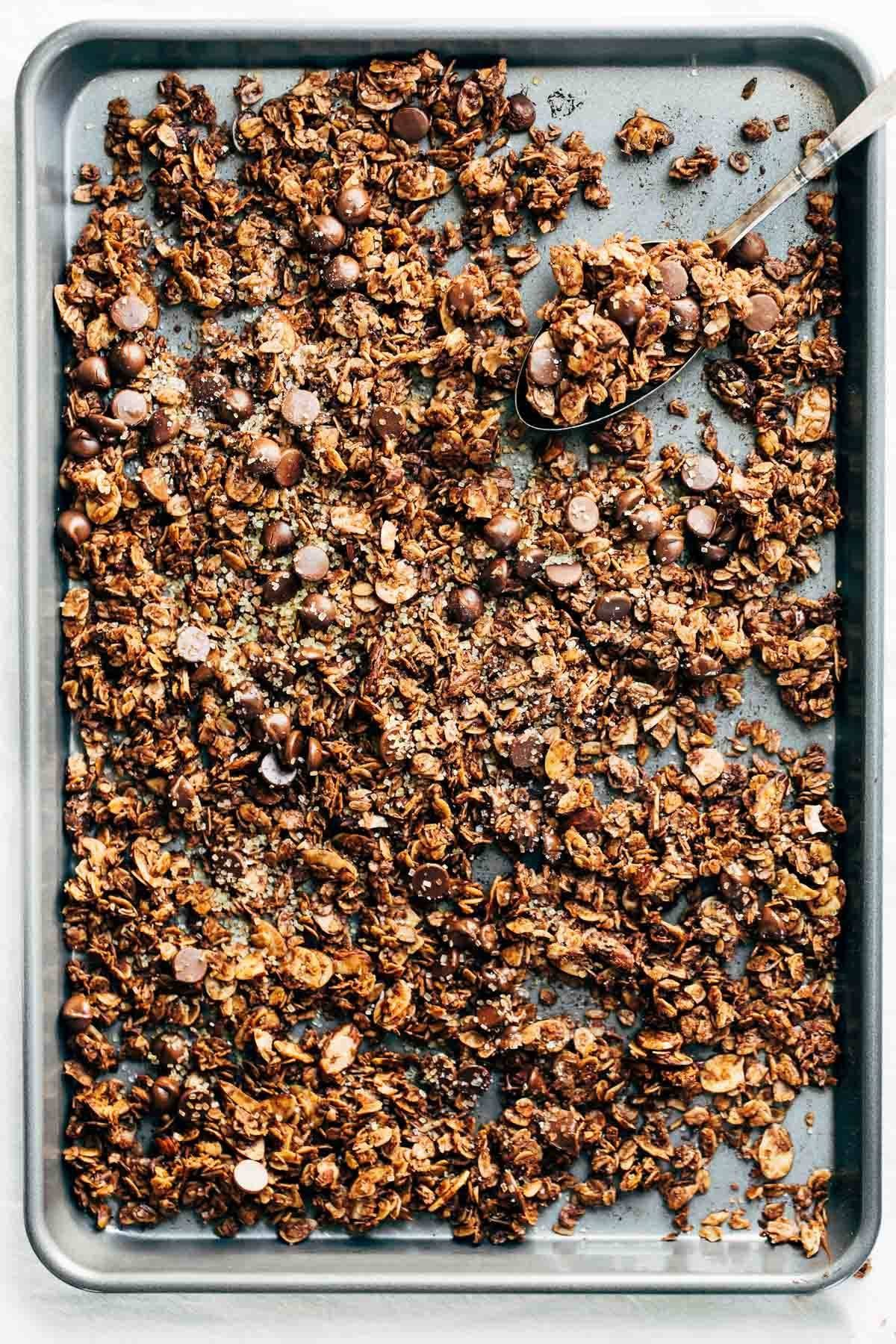 The Ultimate Chocolate Granola - made with oats, almonds, coconut flakes, chocolate chips, and topped with crunchy turbinado sugar and sea salt. Quick, easy, and totally addicting.