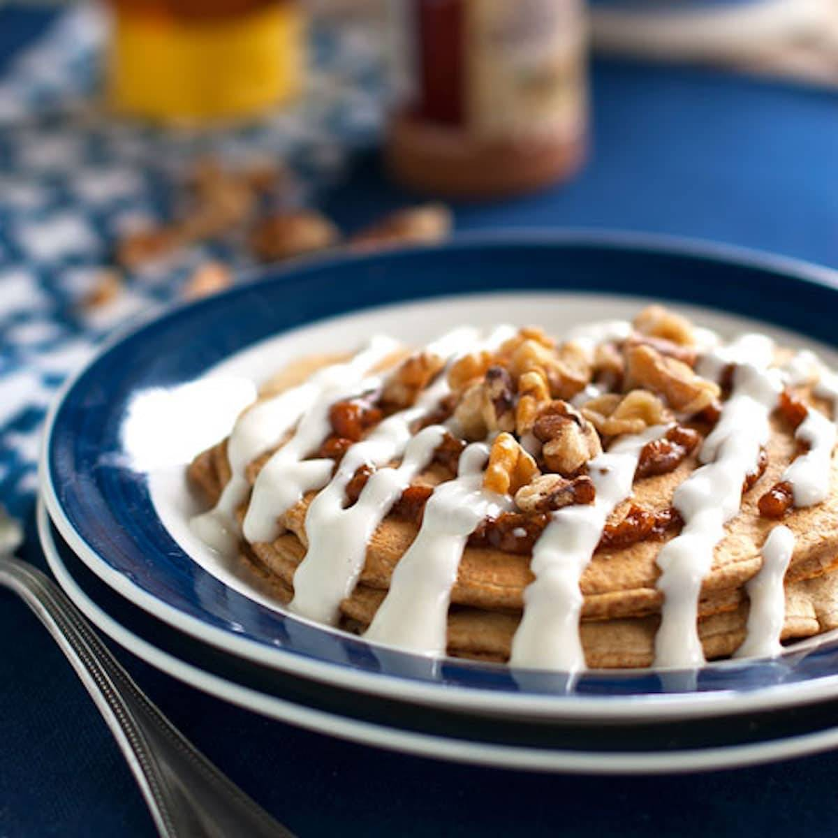 These healthy cinnamon roll pancakes are made with whole grain pancakes, a pumpkin-walnut cinnamon filling and a Greek yogurt frosting. | pinchofyum.com
