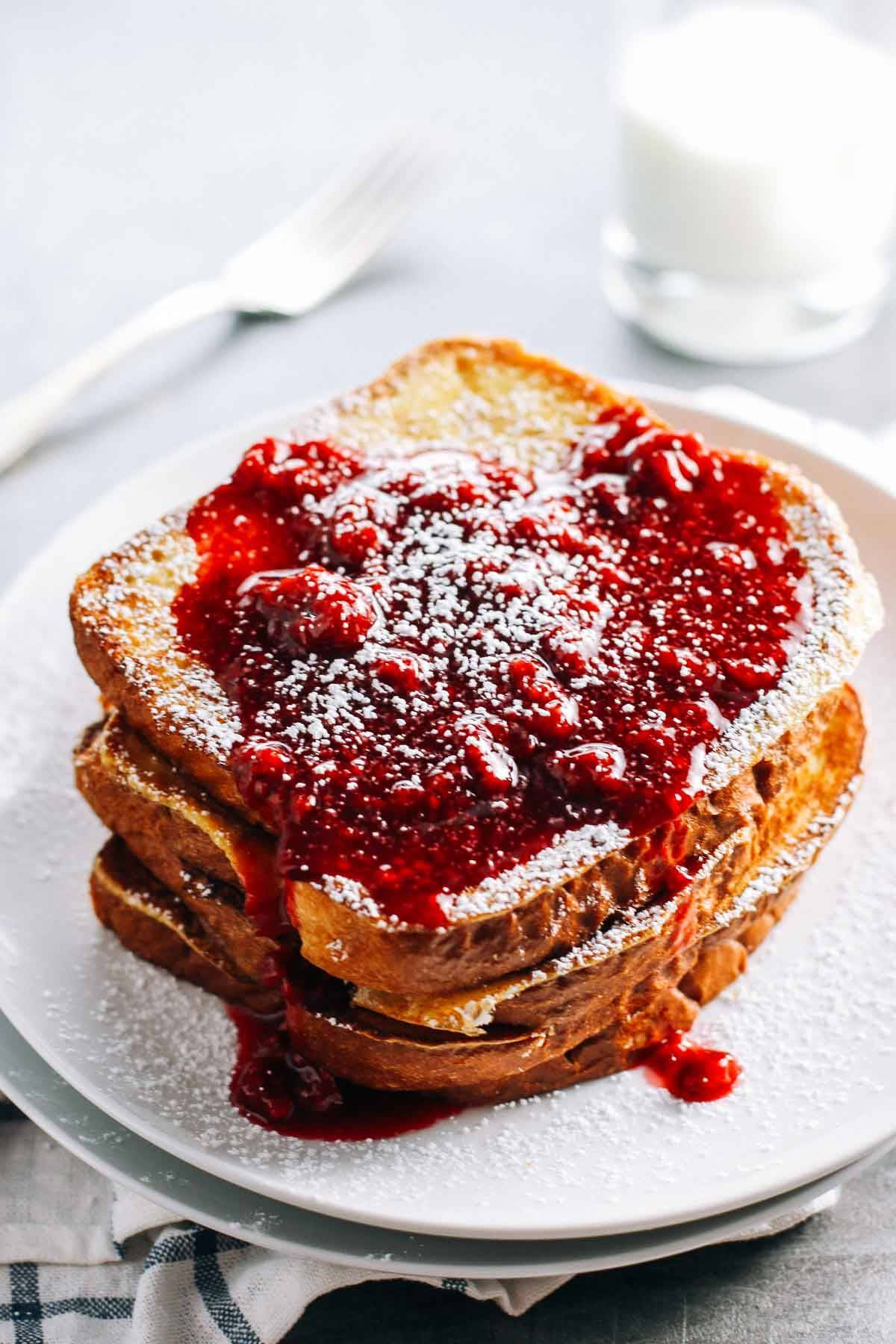 Eggnog French Toast with raspberry sauce.