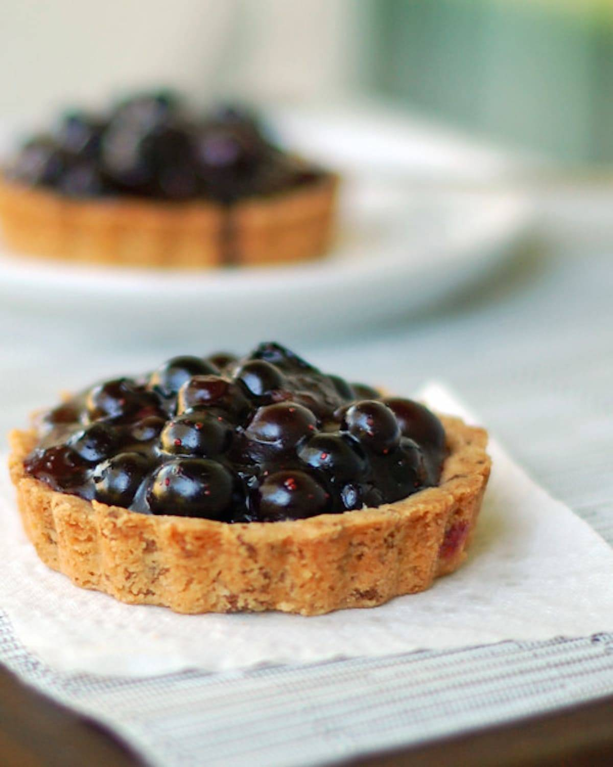 These fresh blueberry tarts have a deliciously textured homemade crust and are packed full of fresh blueberry filling. The best summer dessert! | pinchofyum.com