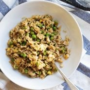 Fried rice in bowl with fork.