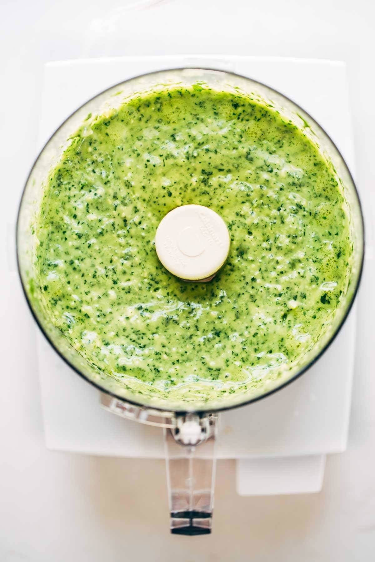 Green sauce in a food processor.