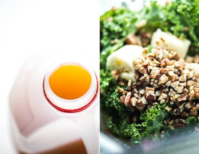 Juice in a bottle and kale with nuts in a blender.