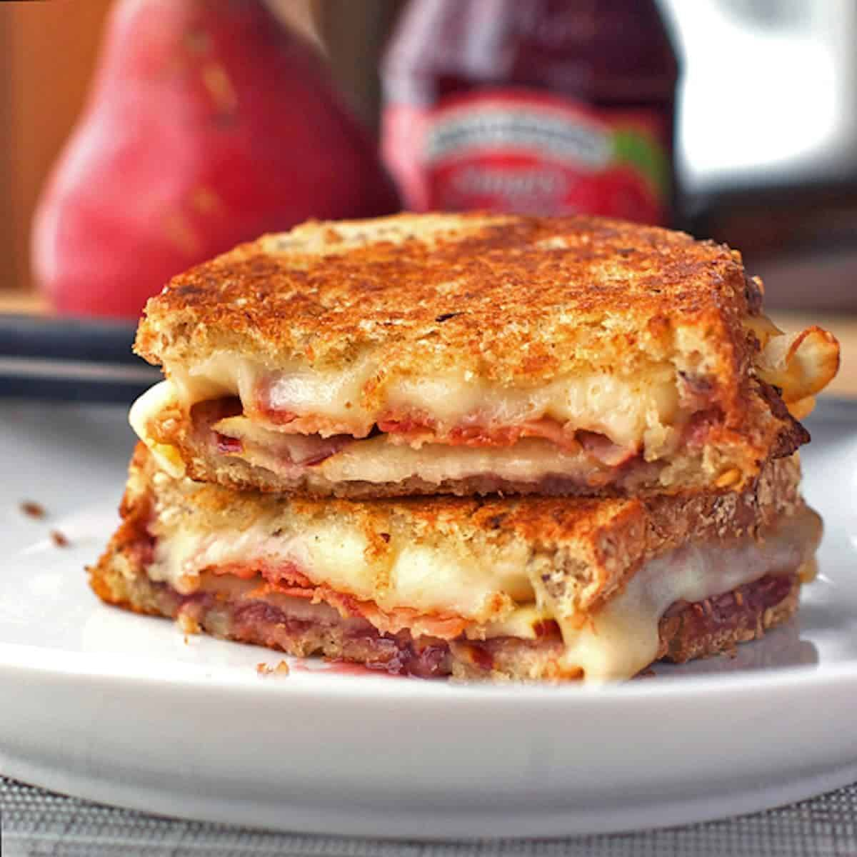 Grilled cheese sandwich stuffed with bacon, pear slices, and raspberry preserves.