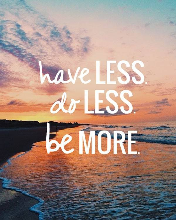 """Have less, do less, be more"" text with a sunset photo."