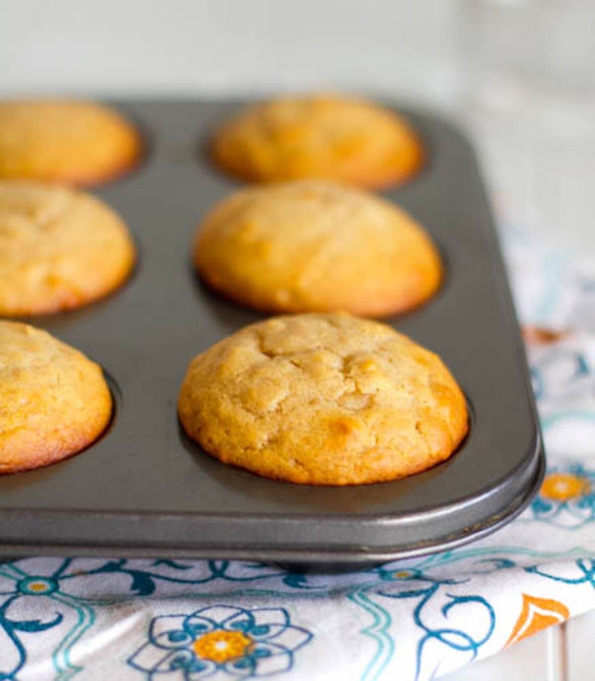 Peanut butter and honey muffins in a tin.