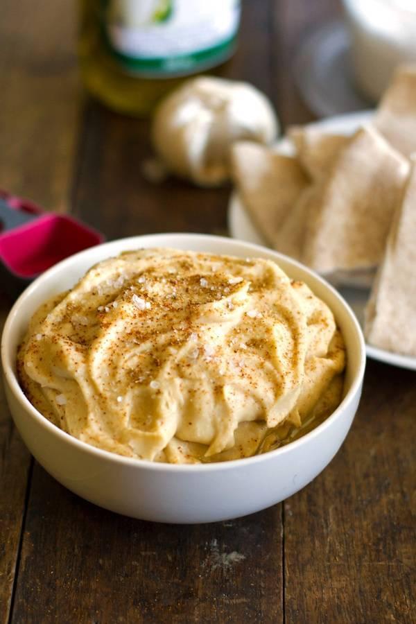Hummus in a white bowl.