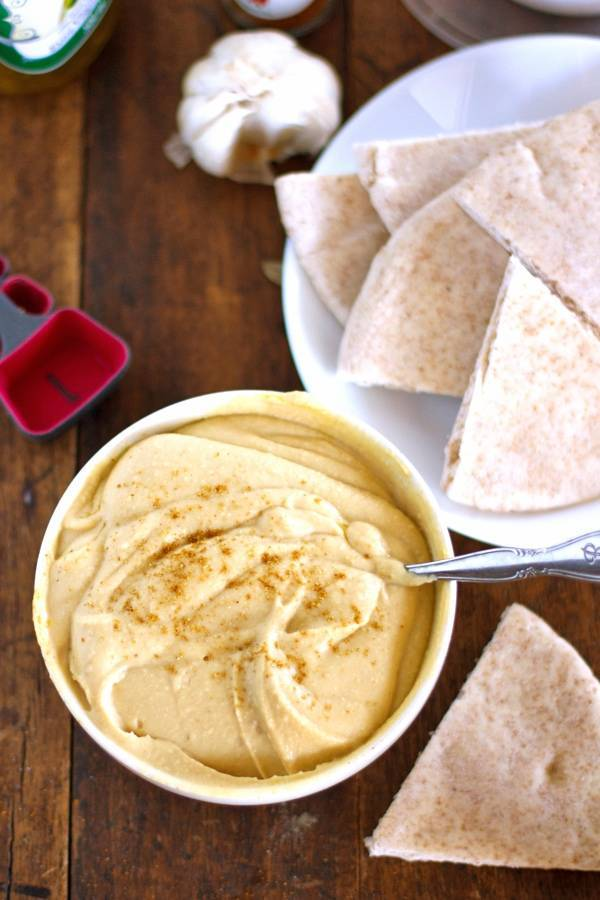 This one little trick will give you the smoothest hummus you've ever had. Basic ingredients - no tahini required. My favorite hummus ever. | pinchofyum.com