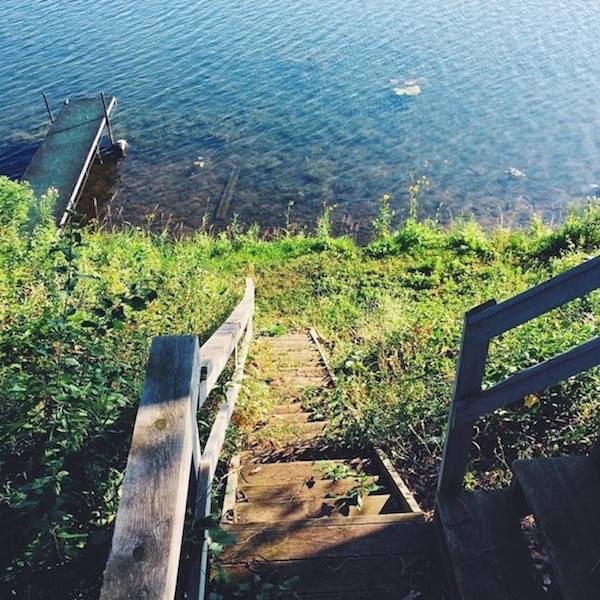 Stairs down to a lake.