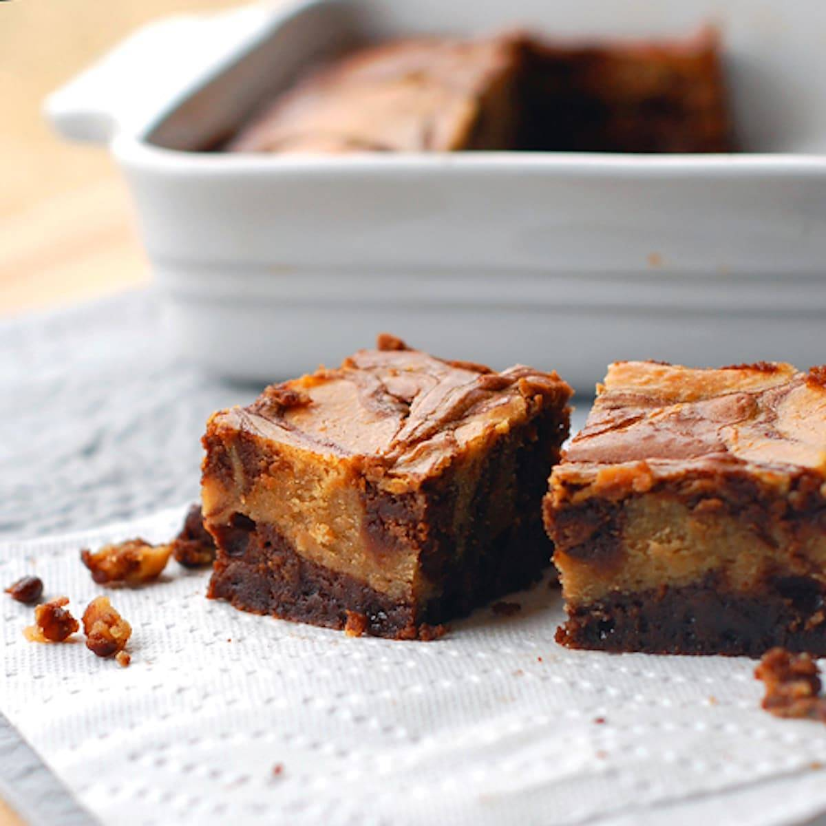 Peanut butter cheesecake brownies on a napkin.