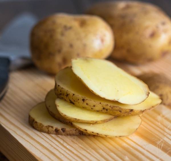 Crispy Potato Mojos sliced on a cutting board.