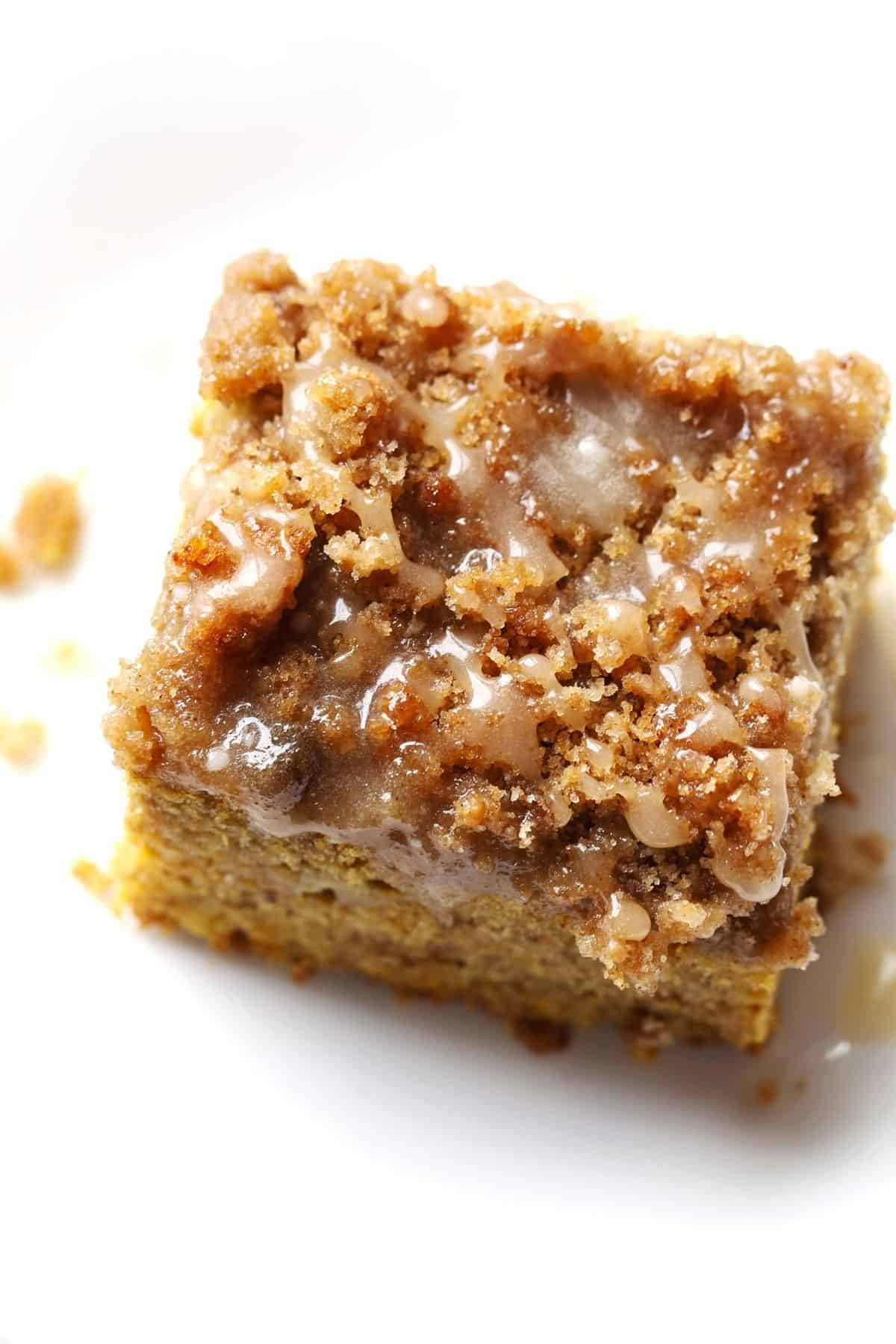 Cinnamon Streusel Pumpkin Coffee Cake with Maple Glaze! This recipe is super easy to make and it will feed a crowd! Perfect for a fall gathering! | pinchofyum.com