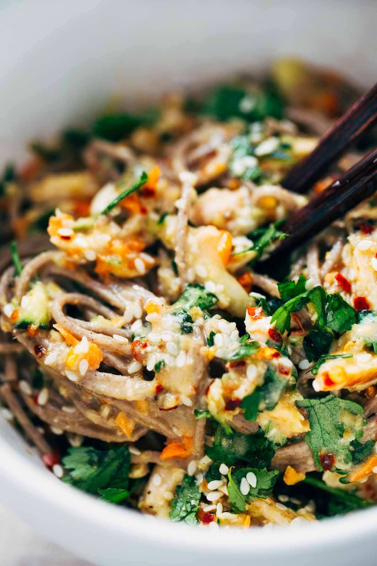 Chopped Chicken Sesame Noodle Bowls - loaded with veggies, chicken, cilantro, and a homemade sesame-peanut sauce. So good! | pinchofyum.com
