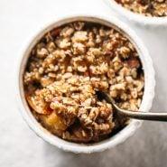 Single Serving Apple Crisp in a ramekin with spoon.