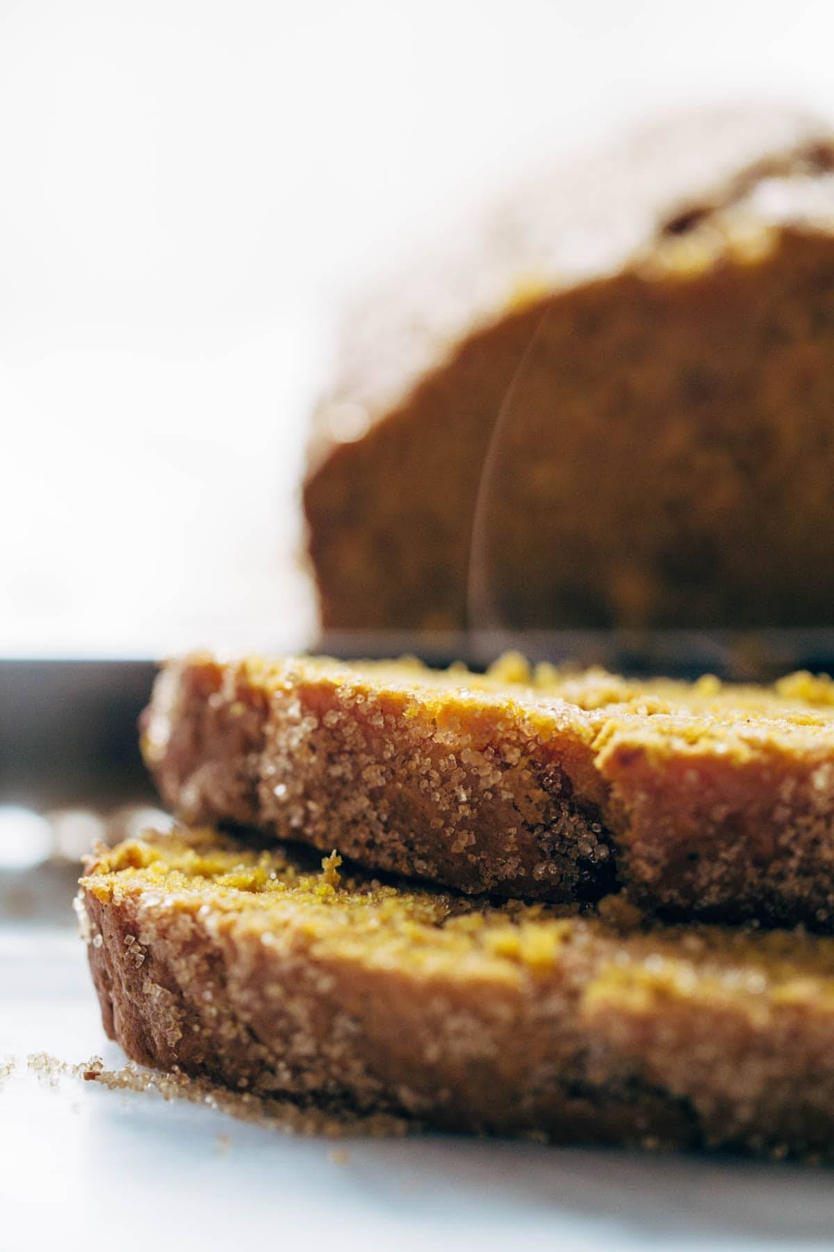This is an easy, classic, super moist pumpkin bread recipe made with olive oil, pumpkin, and cinnamon, and topped with crunchy turbinado sugar. | pinchofyum.com