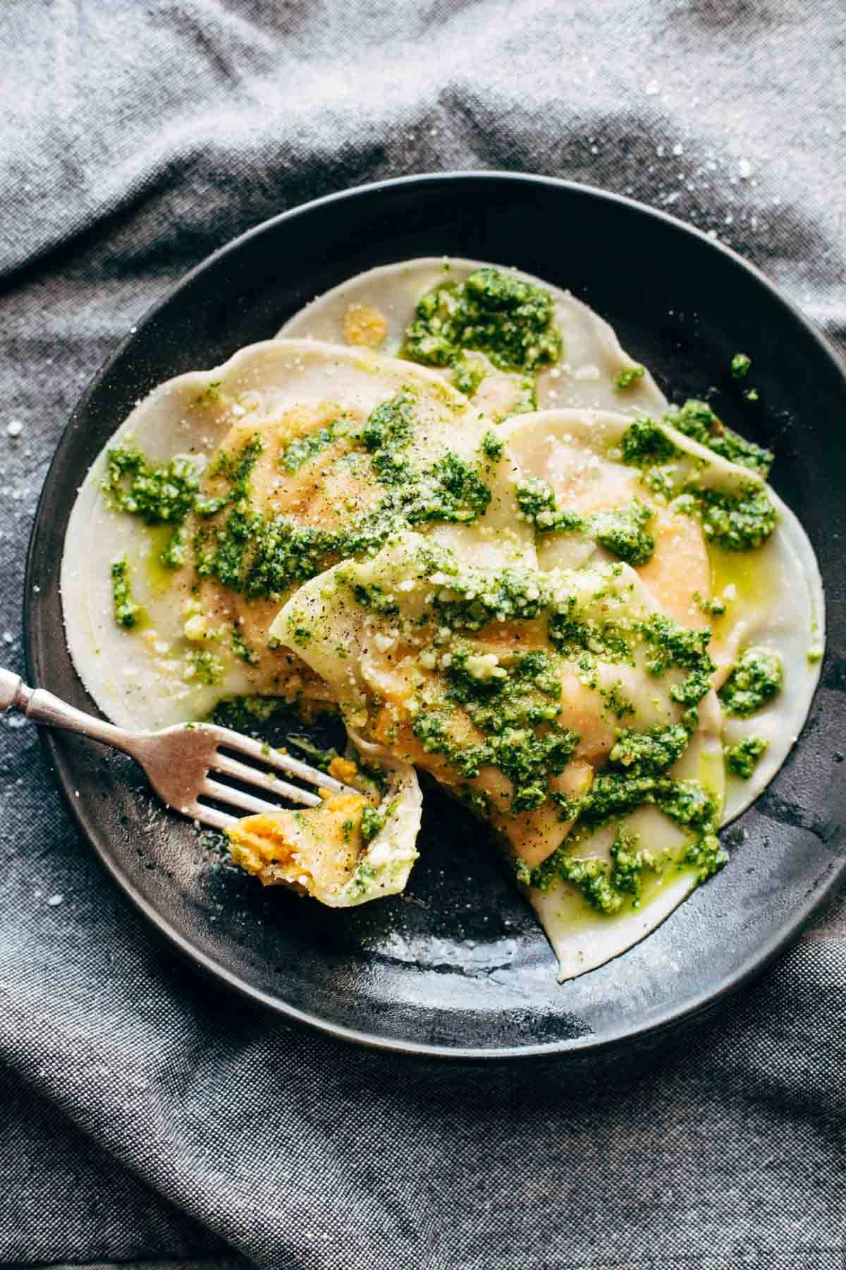 Butternut Squash Ravioli on a plate with a fork.