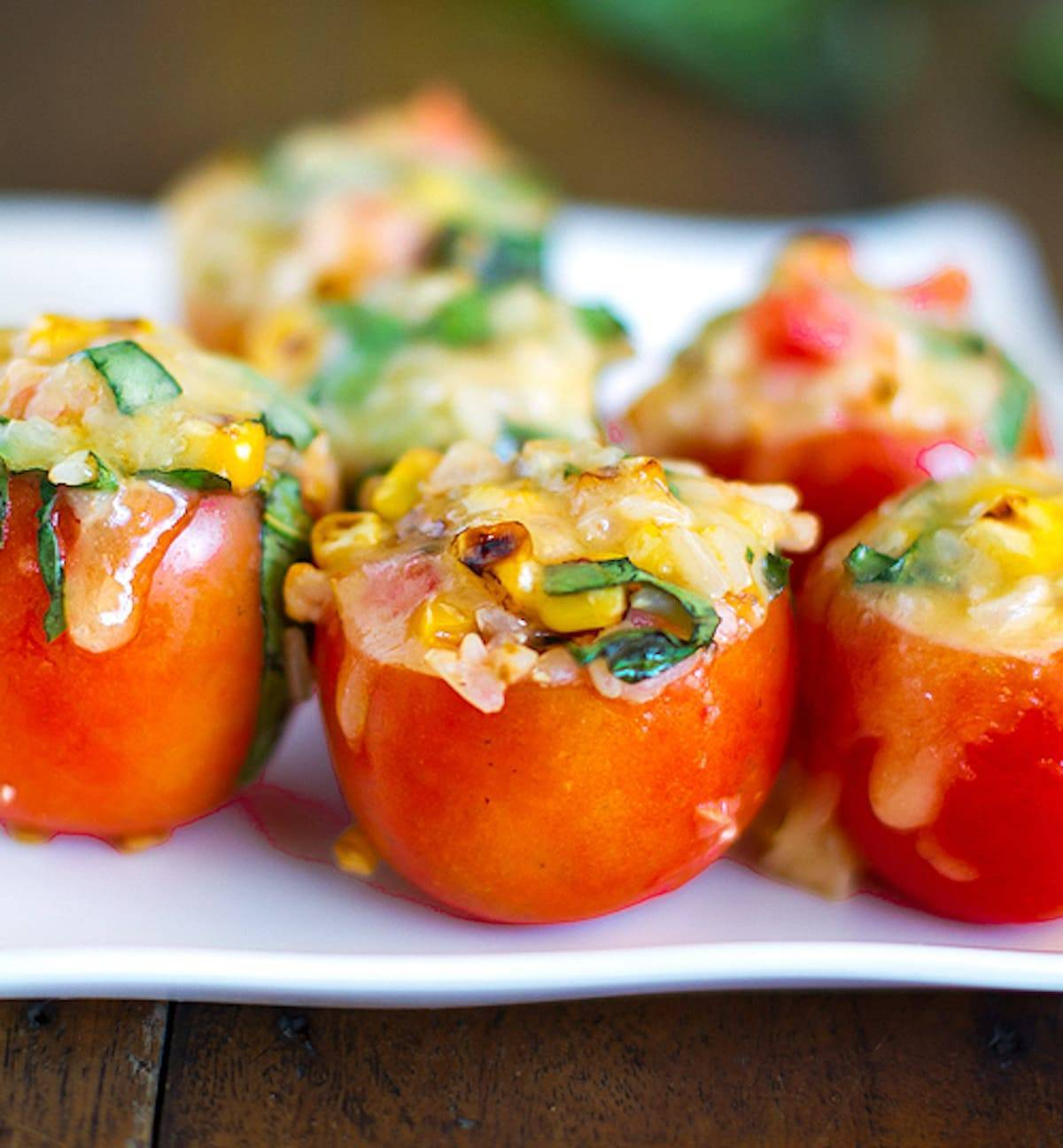 Stuffed tomatoes filled to the brim with roasted corn, fresh basil, and topped with melted Mozzarella cheese.