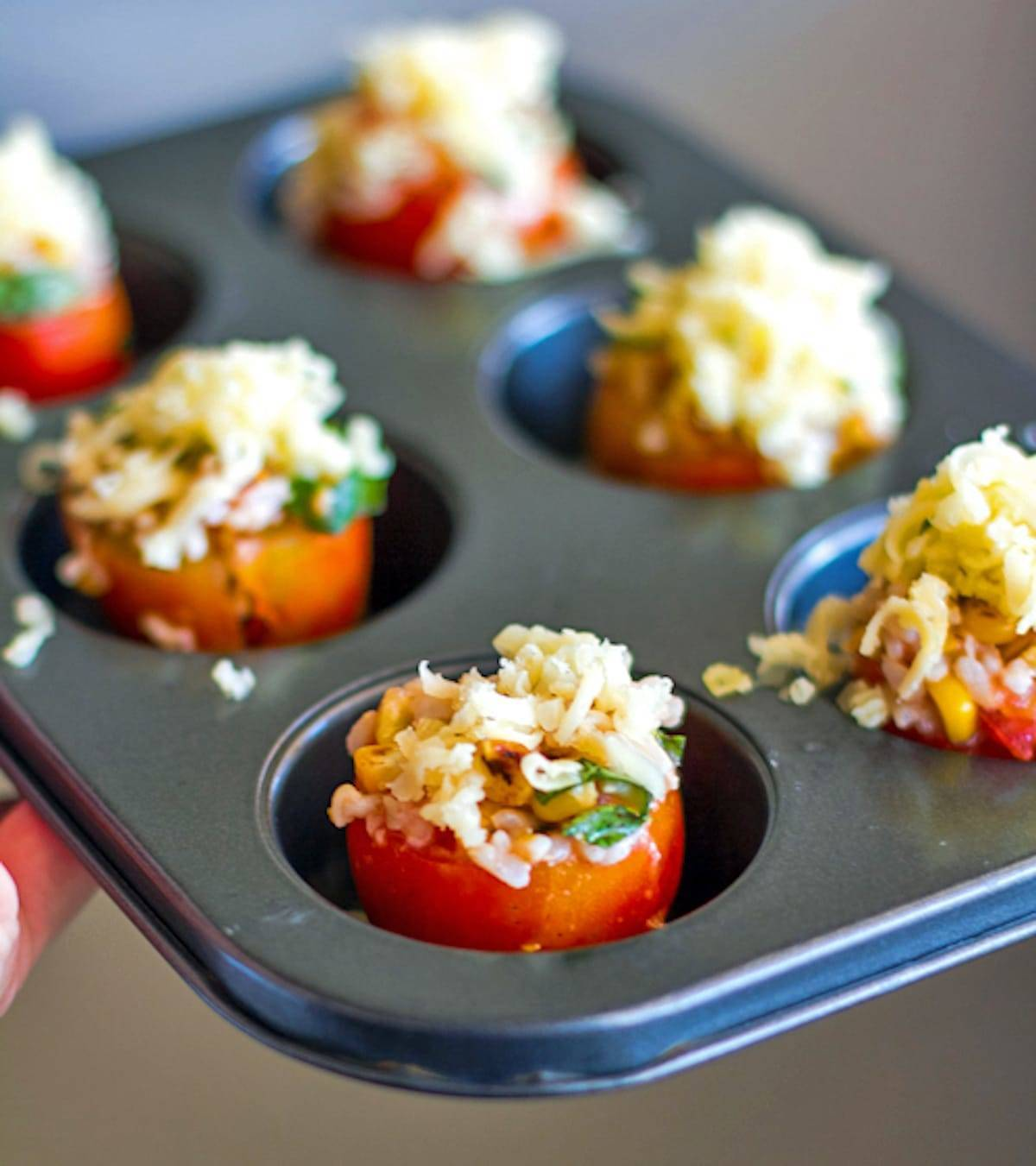 These stuffed tomatoes are filled to the brim with roasted corn, fresh basil, and topped with melted Mozzarella cheese. Simple and healthy! | pinchofyum.com