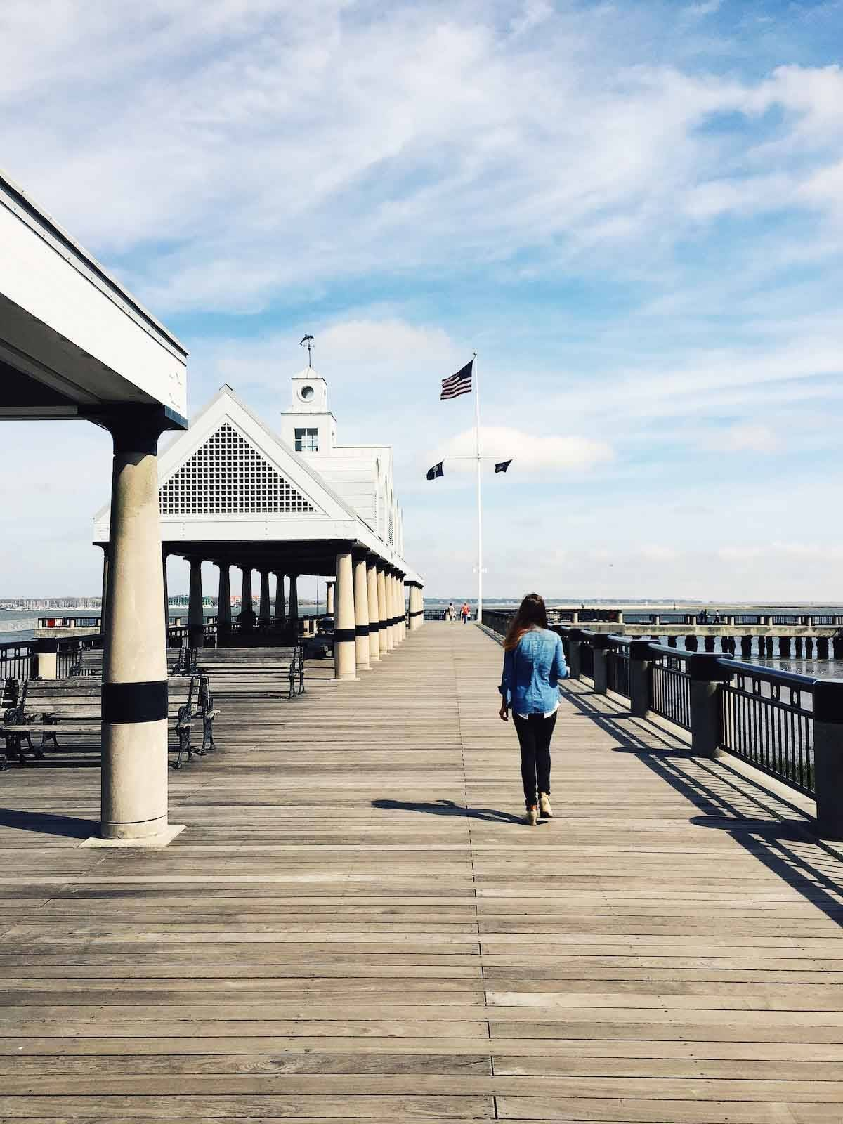 Woman walking down the boardwalk.