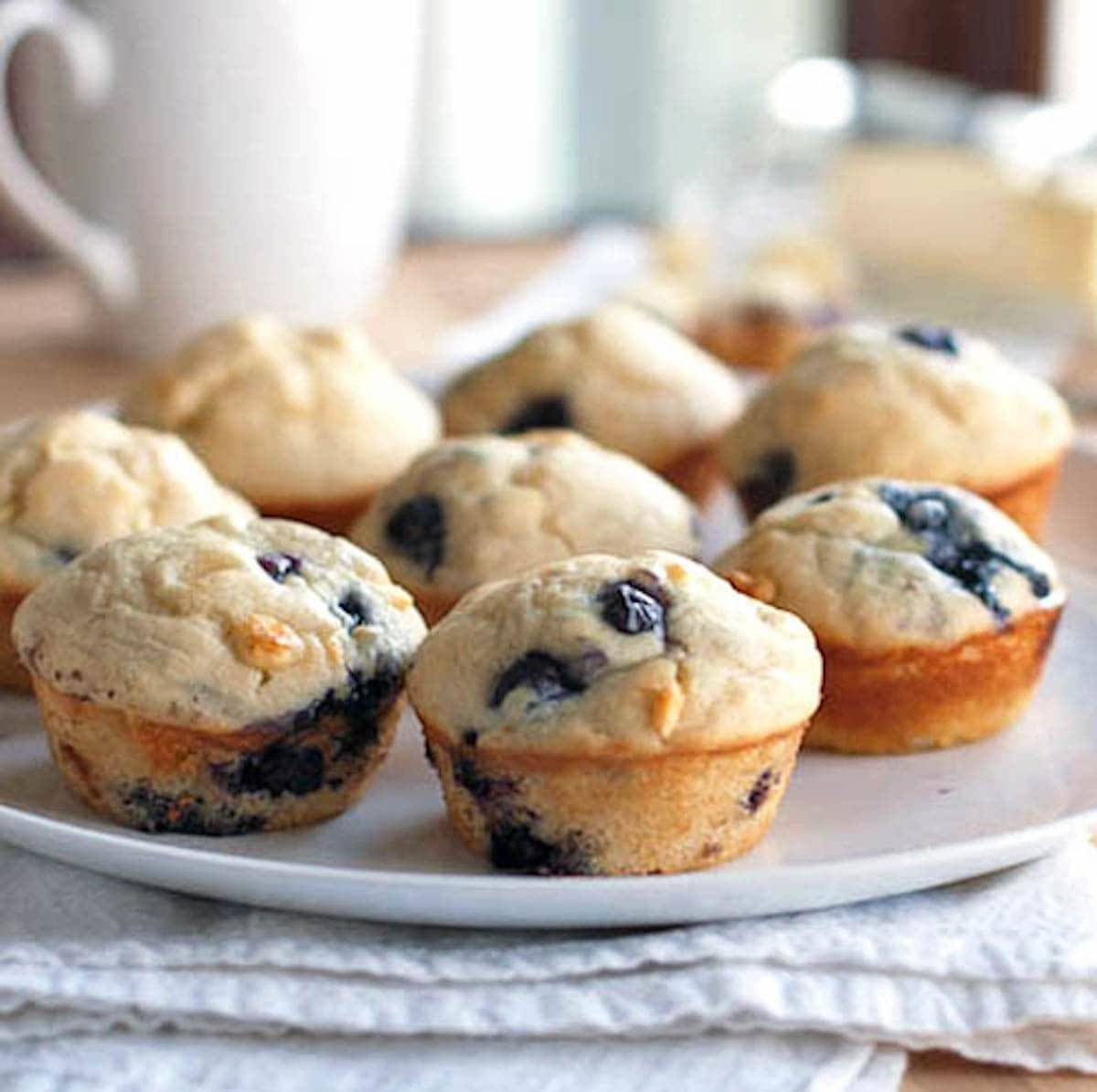 These white chocolate blueberry muffins are loaded with sweet juicy blueberries and white chocolate chips. Perfect for a cozy Saturday morning. | pinchofyum.com