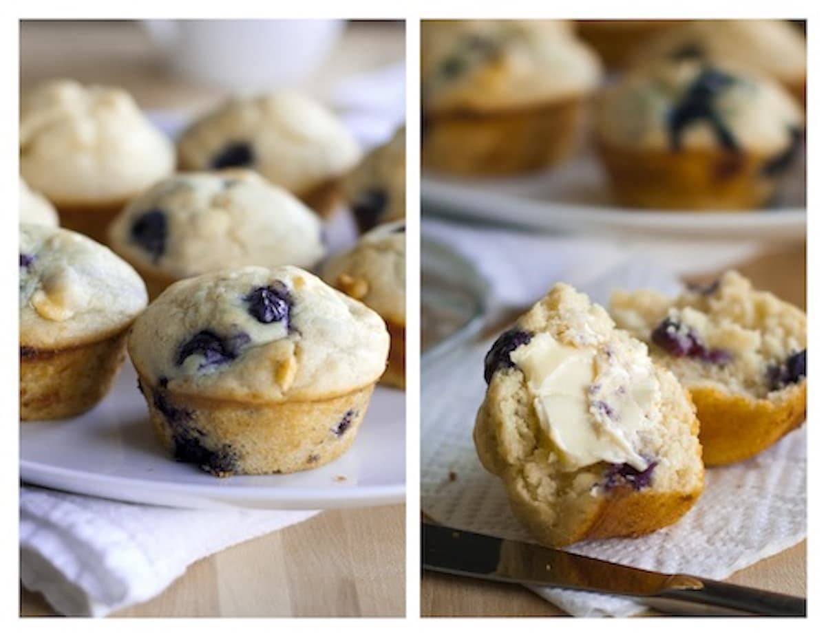 White chocolate blueberry muffins on a napkin with butter.